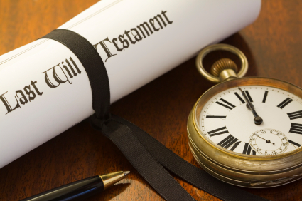 When your time comes to an end. A scroll of a Last Will & Testament, tied with a black ribbon on a mahogany desk, with pocket watch set to midnight: the end of time.